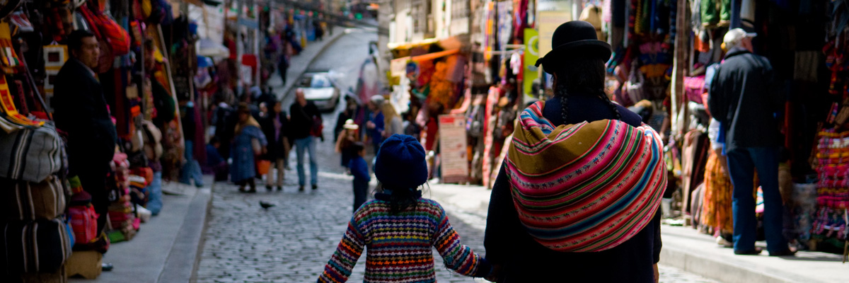 la paz bolivia - women at stalls in witches market