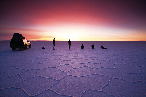 Uyuni Bolivia - People at the salt flats at sunset