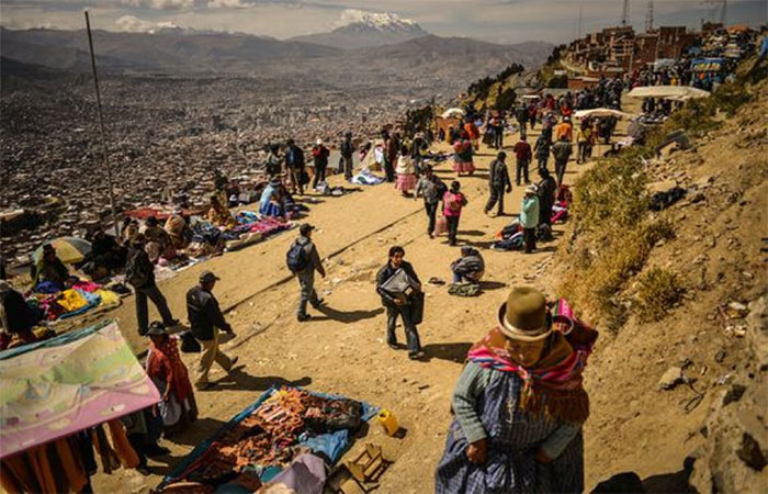 la paz bolivia - locals walking around a street market